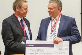 David Smyth (right) presents Crewe YMCA's Richard Holmes with £25,000 donation
