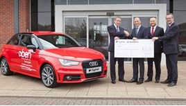 Sytner Group representatives present charity donation of £27,721 to BEN's Gary Cully (left)