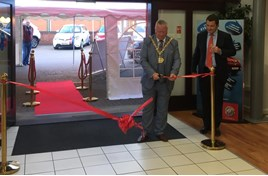Burton-on-Trent mayor, Simon Gaskin, cuts the ribbon at T L Darby's new MG Motors UK showroom