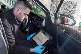 Technician completing a car MOT