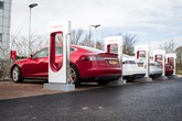 Tesla cars at supercharger EV charge point location