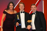 Tim Holden, chief executive,  Holden & Holden, accepts the  award from Michael McVeigh, chief operating officer, AutoProtect, right, and host Lisa Snowdon, left