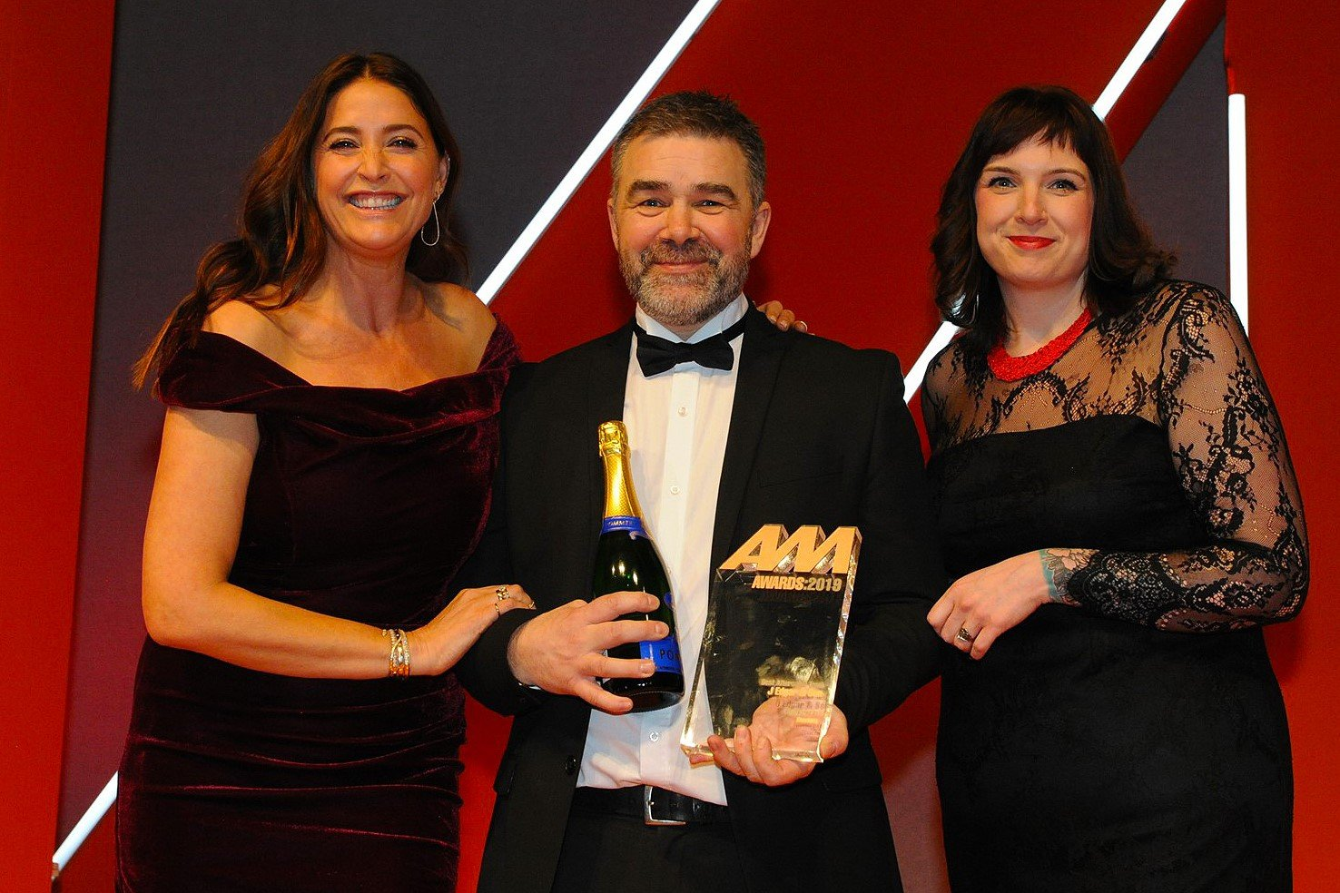 Tony Hodgson, aftersales manager,  J Edgar & Son, accepts the award from  Amy Davis, head of marketing, Gtechniq, right, and host Lisa Snowdon, left