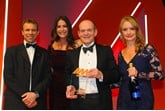 Tony Whitehorn, former chief executive, Hyundai Motor UK, accepts the award from Katie Rugen, UK automotive sales team lead, Shell UK, right, AM editor-in-chief Stephen Briers, left, and host Lisa Snowdon, second from left