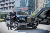 Torsten Muller-Otvos, Rolls-Royce Motor Cars chief executive, with a Rolls-Royce Cullinan