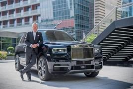 Torsten Muller-Otvos, Rolls-Royce Motor Cars chief executive, with a Rolls-Royce Cullinan
