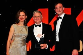 Gary Savage, CEO, Mercedes-Benz UK, accepts his award from host Katie Derham and Simon Webb, head of sales and  development, Premia Solutions (right)