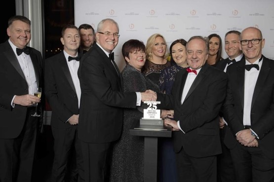 TrustFord chairman and chief executive, Stuart Foulds, and his team receive their Sunday Times Best Companies to Work For award