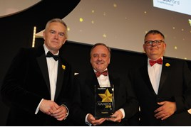 TrustFord chairman and chief executive, Stuart Foulds (centre), receives the Fleet News Fleet Dealer of the Year award