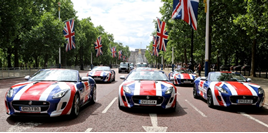 Jaguar cars in Union Jack colours on the Mall