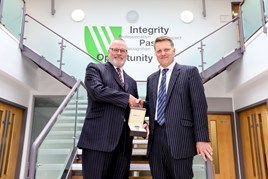 David Jewell receives a parting gift from Vertu Motors CEO Robert Forrester