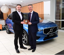 UK Car of the Year director John Challen presents Jon Wakefield, managing director at Volvo Car UK, with the XC60's award