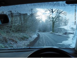Winter road driving conditions out of windscreen