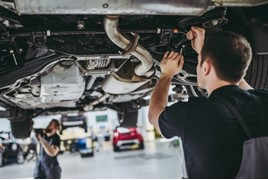 A technician at a work on a car