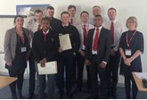 West Way Nissan graduating apprentices from West Way Nissan with their Remit apprentice development coaches