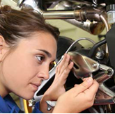 Young technician at work on a car